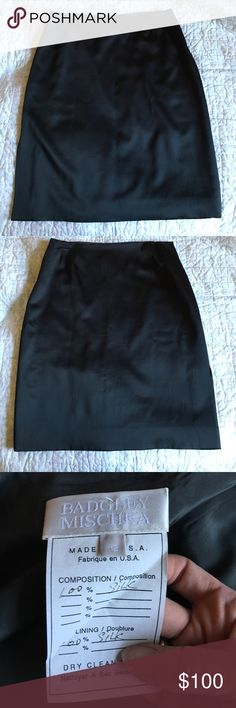 Badgley Mischka vintage silk skirt 12 This is a very fine vintage silk skirt. The silk is kind of rough and textured. The color is very dark blue. It is fully lined in softer silk. Side zip, slit on right side. It has a few very small snags in the top front near the waist, and there are imprints near the waist in four places from the hanger.  I photographed three of them. Some little spots in the inner lining. Badgley Mischka Skirts Midi