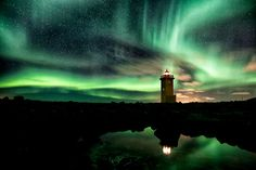 lighthouse and aurora  iceland