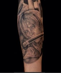 """Part of a Tarantino sleeve that Lajoie is still working on. Excellent black and gray.  Great detailing and from one of my favorite movies, """"Kill Bill""""."""