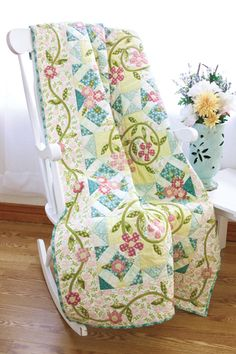 Summer's Trellis: Creative piecing and applique bloom on this summery throw.   Designed by June Dudley, QM Editor-in-Chief, quiltmaker.com. Repin this image for a chance to win a copy of this issue!