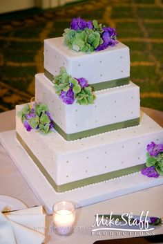 #wedding cake #wedding cake topper #tiered cake #Michigan wedding #Mike Staff Productions #wedding details #wedding photography http://www.mikestaff.com/services/photography #purple #green #white #flowers