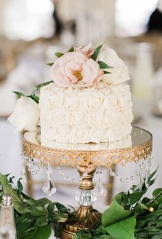A glam wedding cake goes country-chic with frosting floral details.