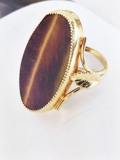 Gold plated synthetic tiger's eye leaf statement ring. Sizeable ans great bohemian style! A personal favorite from my Etsy shop https://www.etsy.com/listing/471266218/vintage-gold-plated-synthetic-tigers-eye