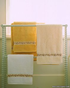 Most linen closets hold a few perfectly usable but mismatched towels. You can easily unify an assortment of solid-colored towels by sewing on washable, decorative ribbon that complements all the hues. Baste ribbon onto the right side of the towel along the dobby trim that is woven into most terry towels, or at a similar distance from the edge, about 2 to 3 inches. Turn the ends of the ribbon under for a neat edge. On a sewing machine, secure the ribbon in place using a small zigzag stitch…