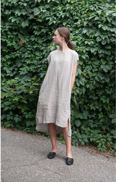 Oversize linen dress for women with short sleeves and pockets. The dress has two functional pockets for your comfort. It is slightly longer at the back for unique style. Wear it loose or combine it with one of our belts for more defined shape. The dress is made from natural Lithuanian linen so