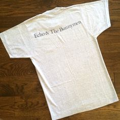"""Echo & the Bunnymen  1984 Vintage Tee Completely underrated, cult favorite Echo & the Bunnymen - if you haven't heard of them you should make your way to iTunes right now! Promo tee for the album """"Ocean Rain."""" I adore this tee but it's snug on me and deserves to be paraded about for all to enjoy. *Price comparison via etsy.  BRAND: Screen Stars MATERIAL: 50/50 YEAR/ERA: 1984 LABEL SIZE: S FITS LIKE: XS/S  MEASUREMENTS: Bust 17 in Length 26 in  Check out my closet for more vintage tees…"""