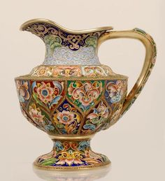 A Russian silver gilt and shaded cloisonne enamel footed creamer, Feodor Ruckert, Moscow, 1896-1908.