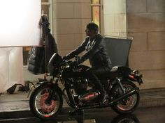 Hannibal Season 3 set photo. And yes that's him on a motorcycle!  This isn't in Paris. They're setting in Toronto but making it look like Paris.