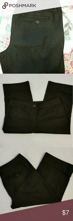 ANN TAYLOR LOFT CAPRI PANTS Ann Taylor Loft Capri pants black with a pinstripes and cuff on botton. Never worn Ann Taylor Pants Capris