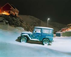 Blue Toyota FJ40 in the snow. Great for off roads!