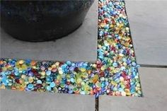 colored glass Instead of gravel in the garden or patio...you can get these @ the dollar store. by ghettoflower