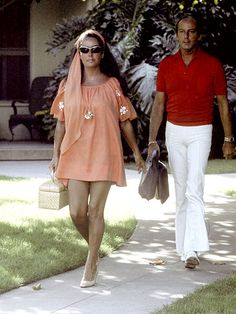 1982 may have marked the end of Taylor's marriage to Sen. John Warner (not pictured), but it also heralded a feminine and sweet style for Liz, like this orange sundress.