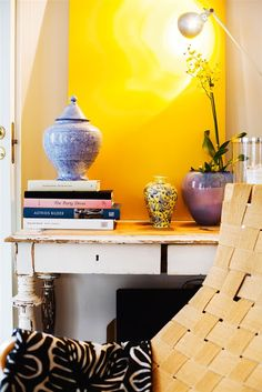 Cool Eclectic Stockholm Apartment In A Mix Of Colors : Eclectic Stockholm Apartment In A Mix Of Colors With White Yellow Wall And Table With Books And Wooden Chair And Black White Towel And Door Wall Shelving Systems, Old Wood Table, Stockholm Apartment, Home Coffee Tables, Yellow Walls, White Towels, Eclectic Style, Mellow Yellow, Entryway Decor