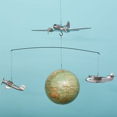 Around the World Mobile ($80): Your lil boy will travel around the world while enjoying this aviator mobile. With realistic model planes zooming around an old-school globe, this mobile is perfect for any lil jet-setter.