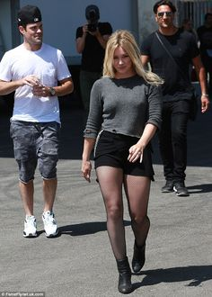 Hillary Duff in sexy outfit with black fishnets pantyhose and heels Style Hilary Duff, Hilary Duff Legs, Pantyhose Outfits, Black Pantyhose, Black Tights, Black Fishnets, Black Shorts, Nylons, The Duff
