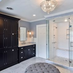 Carrara marble paired with contrasted with black cabinets make for a luxurious master bathroom. Finished with Polished Nickel Cup Pulls and Latches by Top Knobs. Bathroom Drawers, Wooden Bathroom, Bathroom Sets, Master Bathroom, Tub Faucet, Black Cabinets, Bathroom Wallpaper, Drawer Knobs, Amazing Bathrooms