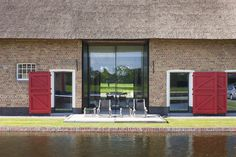 This old farmhouse in Knokke, Belgium was converted by architect Stephane Boens www.vitrocsa-uk.com