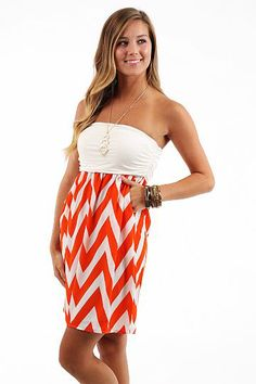 Pump It Up Dress, orange/white $44 www.themintjulepboutique.com