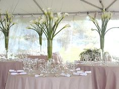 Simple centerpieces which give great height and yet don't look crowded.