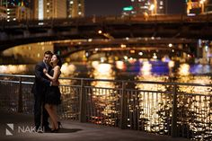 Downtown Chicago River Engagement Photos by Chicago Engagement Photographer - Nakai Photography! Romantic night photographs! Beautiful Creative Chicago engagement pictures! Reflecting lights. http://www.nakaiphotography.com