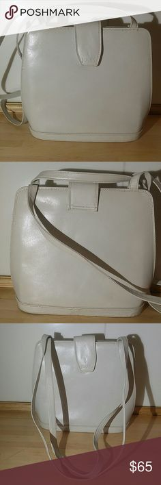Stunning Vintage White Handbag by Joop Stunning Vintage White Handbag by Joop. This is a Beauty !  In Very Good Condition. Great Lifestyle Bag for Work or Play. Double Extra Long Straps. Stiff Structured Handbag with a Really Cool Shape. Can Sit Upright on it's Own. Pinstripe Black and White Lining. 2 Main Compartments 1 Inside Zipper Compartments. Just an Awesome WHITE Bag to Own. Vintage Bags