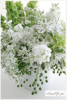 Lovely arrangement of greens and whites with bells of Ireland. So perfect for Saint Patrick's Day.   by acreativemint, via Flickr