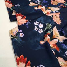 A gorgeous and luxurious light-weight polyester fabric that is soft and drapes well. It is suitable for a wide range of dressmaking projects such as dresses, skirts and blouses.]Read More. Floral Tops, Floral Prints, Sew Over It, Navy Blue Background, Crepe Fabric, Sicily, Dressmaking, Digital Prints, Blouses
