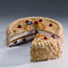 Tort Śmietankowy Przeznaczony dla dzieci - tort bez dodatku alkoholu. Warstwy ciasta biszkoptowego przekładane bitą śmietaną wymieszaną z całymi wiśniami. Środkowy blat wykonany z kolorowej galaretki.