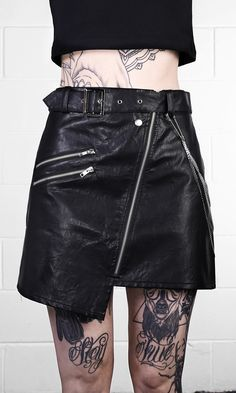 """Vegan leather deconstructed biker jacket skirt with asymmetric hem. Buckle and zip details with and detachable triple belt chains. Slim fit A-line mini skirt. Model is 5'9"""" and is wearing size Medium. WE SHIP WORLDWIDE! TAG YOUR PURCHASE: #disturbiaclothing IN STOCK & SHIPS WITHIN 24 HOURS"""
