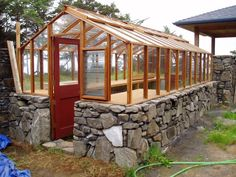 9 x 18 Deluxe redwood greenhouse on stone base