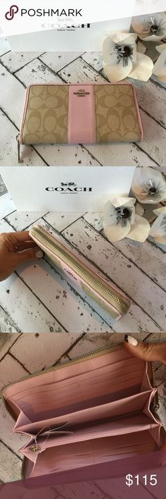 NWT COACH Wallet Brand new with tags authentic Coach Wallet. Beautiful light khaki pebbled leather with pink leather trim. Finished with silver hardware. Tons of internal storage space with plenty of credit card slots!      comes in coach gift box Coach Bags Wallets