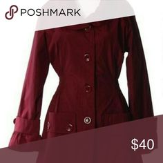 Maroon button down jacket Nice rayon/polyester blend belted jacket.  Hits at the top of the thigh. Bottomed sleeves helps keep wind out of the sleeves. Nice for dress or casual wear.  Has a slight satiny look which makes it water resistant.  Maroon color only. Jackets & Coats
