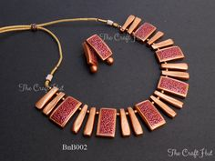Handcrafted choker style Terracotta Necklace set in rustic gold and maroon Fancy Jewellery, Funky Jewelry, Simple Jewelry, Jewelry Crafts, Handmade Jewelry, Thread Jewellery, Jewelry Shop, Terracotta Jewellery Making, Terracotta Jewellery Designs