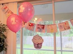 1st Birthday Banner, made with photos of monthly baby pictures of the first year.
