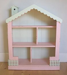 How cute is this dollhouse bookcase from Layla Grayce? It retails for a small fortune but I think with a little sweet talk and wavi...