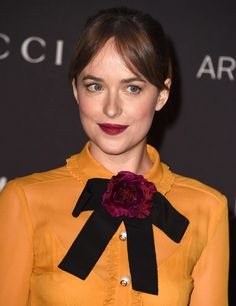 Try a deep wine lip like Dakota Johnson, which looks extra chic with a prim top or blouse. | 15 Cool Holiday Beauty Looks for 2015