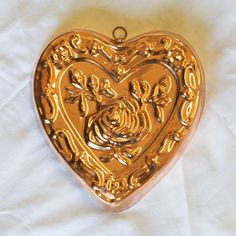 "This 10"" x 2"" tin lined copper mold is heart shaped and features an exquisite rose design in the centre. Hand produced in Istanbul, Turkey."