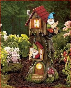 Put a smile on the faces of passersby with a Solar Gnome Tree House in your yard. This whimsical garden accent features windows that light up using the power of the sun. Turns on automatically at dusk. House Yard, Gnome House, Outdoor Landscaping, Outdoor Gardens, Outdoor Decor, Outdoor Lighting, Resin Garden Statues, Garden Items, Gnome Garden