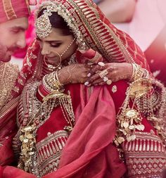 12 Ideas To Steal from Deepika and Ranveer's Wedding! | For the North Indian Sindhi ceremony, Deepika wore a Matka silk red lehenga with a gold high neck blouse and double dupatta. #weddingideas #bridallehenga #silklehenga #bridalwear #indianbrides
