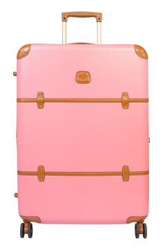 Traveling the world in style with this darling pink trunk.