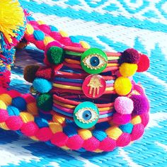 Have a pompom party with #danalevy neon evil eye &  hamsa hand lucky charm friendship bracelets this summer