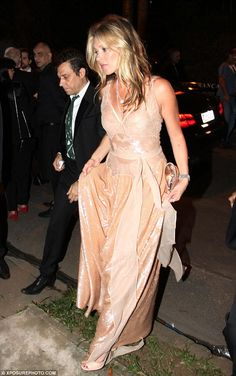 Side by side: Moss held her dress up to avoid getting her heels caught on the delicate fab...