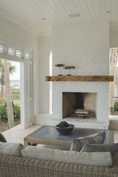 Seaside Style: Sea Shell Chic. Painted fireplace done well.