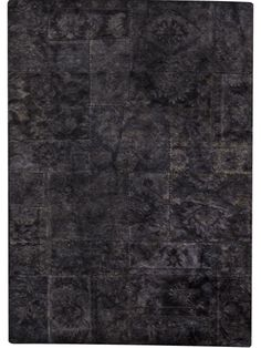 Sarangi - Black is a hand tufted, hand-stitched rug that is made of 100% wool. This rug embodies the concept of recycling. It is not made of new yarn, but  made using the left over yarn from other rugs that has been re-dyed/over-dyed. Made in India.