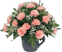 My favorite flower arrangement - pink carnations and white baby's breath.