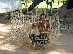 Basket weaver making a chicken coop, Vientiane, Lao Peoples Dem Rep