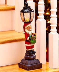 """Bring warmth to your winter decor with a Lighted Holiday Lamppost. Add the lamppost to your existing decorations, or let it serve as the focal point for something new. On/off switch. Requires 3 """"AAA"""""""