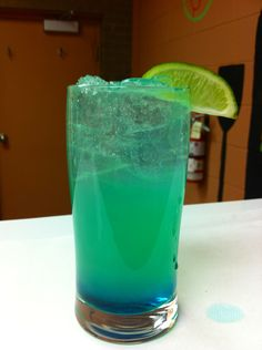 Electric popsicle. Melon liqueur, Blue Curacao, Sprite, ice, lime wedge.
