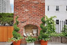 This NYC apartment has a brick fireplace on its rooftop.