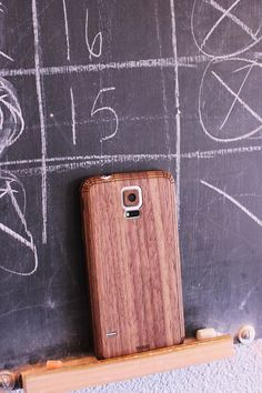 Suit up your Galaxy S5 with a real wood cover fit for the space age.  Beautifully engineered with precise details, laser-cut & hand-finished.  Simple peel & stick application.  Includes back cover, side wraps, lens ring cover & button covers.  Allows for easy access to all ports & removal of back panel.  Add a front cover to take it to the next level.